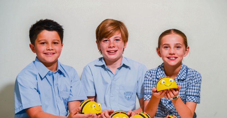 Our Lady of Fatima School students Kai Travia-Kathiravelu, Riley Robinson and Sophie Gault, all nine, with ozbots in their technology lab. Picture: Iain Gillespie/The West Australian