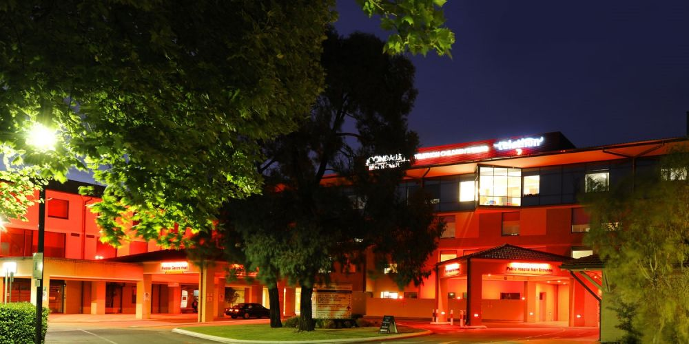 Joondalup Health Campus exterior illuminated with red lights for 2019 Telethon.
