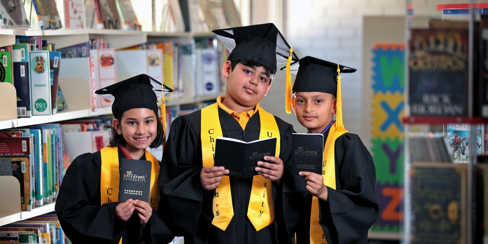 Year 4 students L-R: Faith Morris (9), Manan Oberoi (10) and Ishmeet Singh (9) with their learning passports.  Morley Primary School students are graduating from the ECU's Children's University program.  Picture: David Baylis.    www.communitypix.com.au   d496467