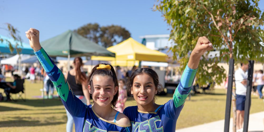 Yanchep Secondary College cheer squad members Taneisha Prior, Devki Bhatia. Pictures: Nicola Edwards