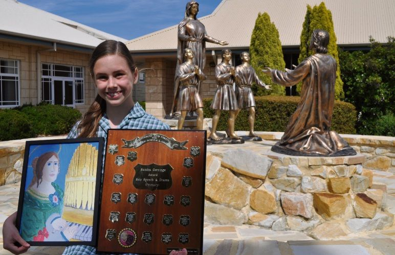 St Jerome's Primary School student Lauren Branch with her awards. Photo: Ben Smith.