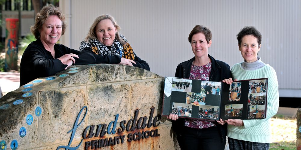 Landsdale Primary School deputy principal Leanne White, teachers Maryanne Lewis and Belinda Scott and library officer Sharon Murray with a school photo album. Pictures: David Baylis www.communitypix.com.au d496628