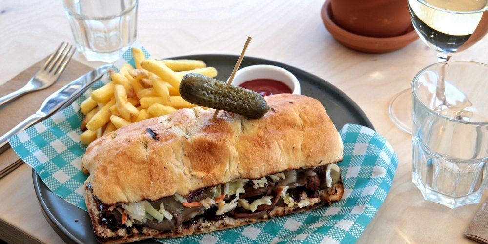 Brisket sandwich with pepper jack cheese, jalapeno, pickles, sriracha slaw, barbecue sauce, panini and fries at The Amberton Beach Bar and Kitchen. Pictures: David Baylis www.communitypix.com.au d496751