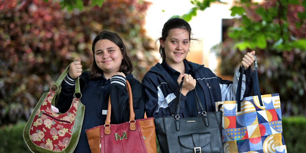 Year 8 students L-R: Ava Harper (13) of Inglewood and Abby Parkinson (13) of Bayswater with some of the bags filled with the collected items. Picture: David Baylis.   www.communitypix.com.au   d496588
