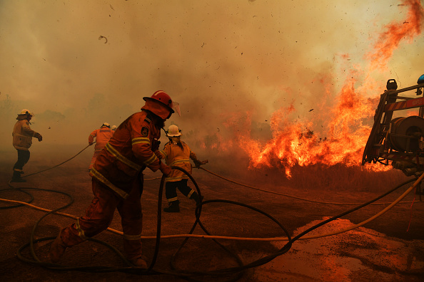 Rural Fire Service firefighters battle a spot fire in Hillville, NSW. Picture: Sam Mooy/Getty Images