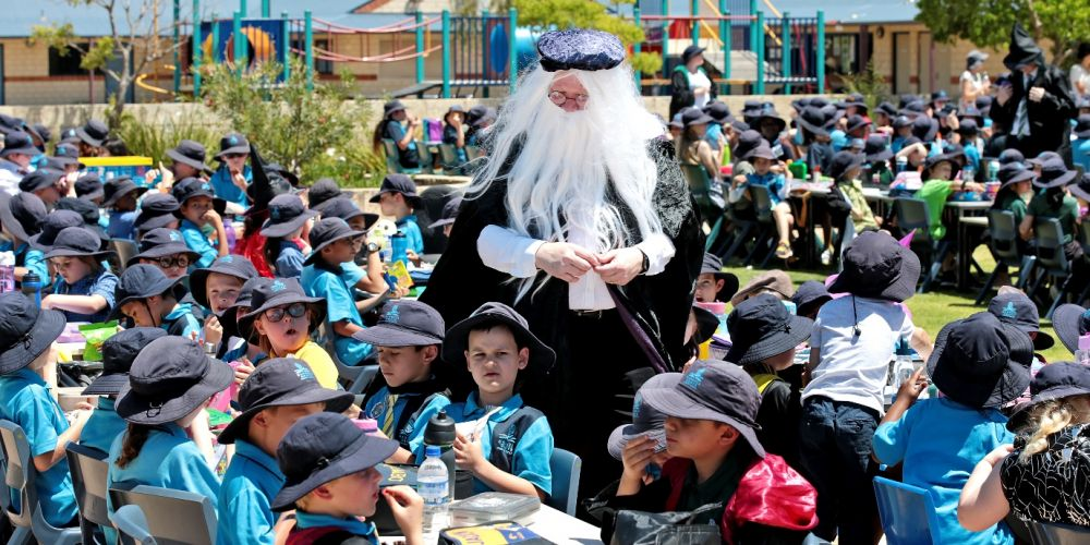 Banksia Grove Primary School principal David Hall wanders amongst the tables at the Harry Potter long table feast. Picture: David Baylis www.communitypix.com.au d496747