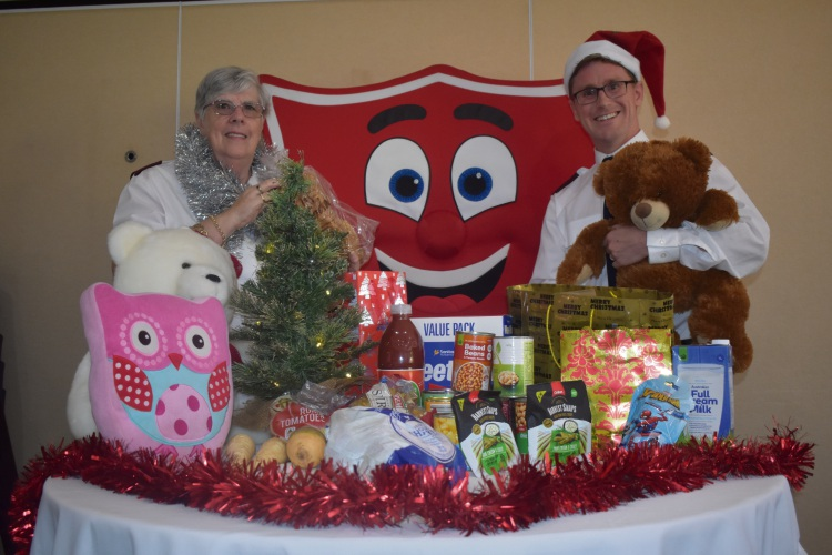 Major Val Wilson with Captain Scott Ellery with some of the items provided in the Christmas Hampers.