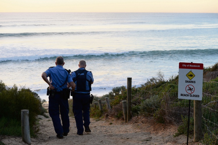Police at Falcon Bay where Ben Gerring was fatally mauled by a shark in 2016. Picture: Daniel Wilkins.