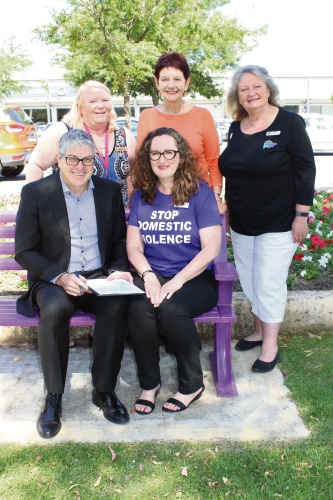 City of Mandurah chief executive Mark Newman signs the pledge with Pat Thomas House executive officer Jill Robinson, Peel Says No To Violence group chairperson Sue Fyfe, Peel Youth Services chief executive Liz Prescott and Nicole Lambert.