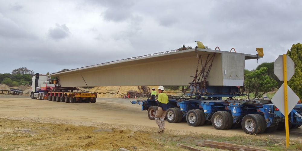 A bridge beam being delivered to the flyover construction site. Picture: Gary Tate