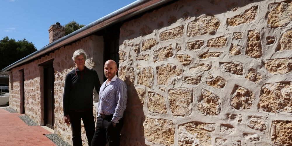 Bernard Seeber Architect Jonathan Strauss (left) and MercyCare major capital projects manager Adam Roebuck stand outside the restored Stables at Wembley