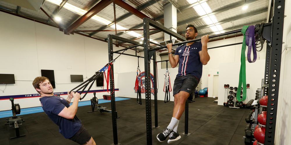 Farran Batchelor (manager F45 Canning Vale) and Ash Menon (trainer) test my favourite exercise chin-ups (just kidding).