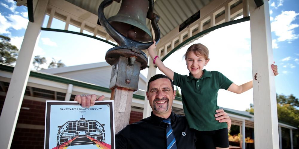 Nathan Setzinger of Forrestfield who left Bayswater Primary school in the Class of 83 with his daughter Edith (7) who is in Year 1 at the school.  Seen here with the replica of the original 1894 school bell at Bayswater Primary School.  Picture: David Baylis    www.communitypix.com.au    d496869