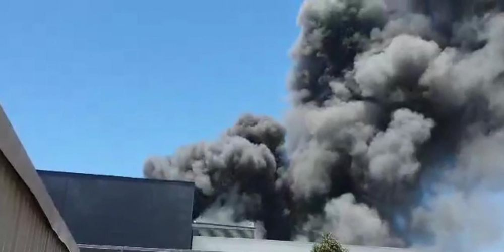Smoke spewing from the Cleanaway building. Photo: Mark Nowicki