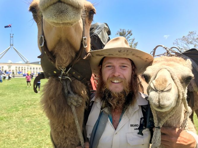 John Elliott and camels Ted and Charlie. Photo: AAP