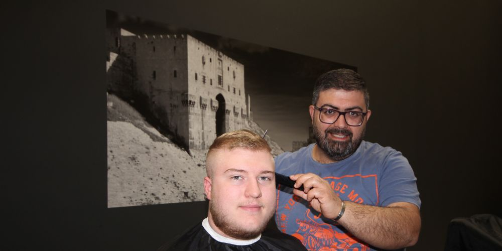 Close shave in war leads Syrian man to start life afresh as Perth barber
