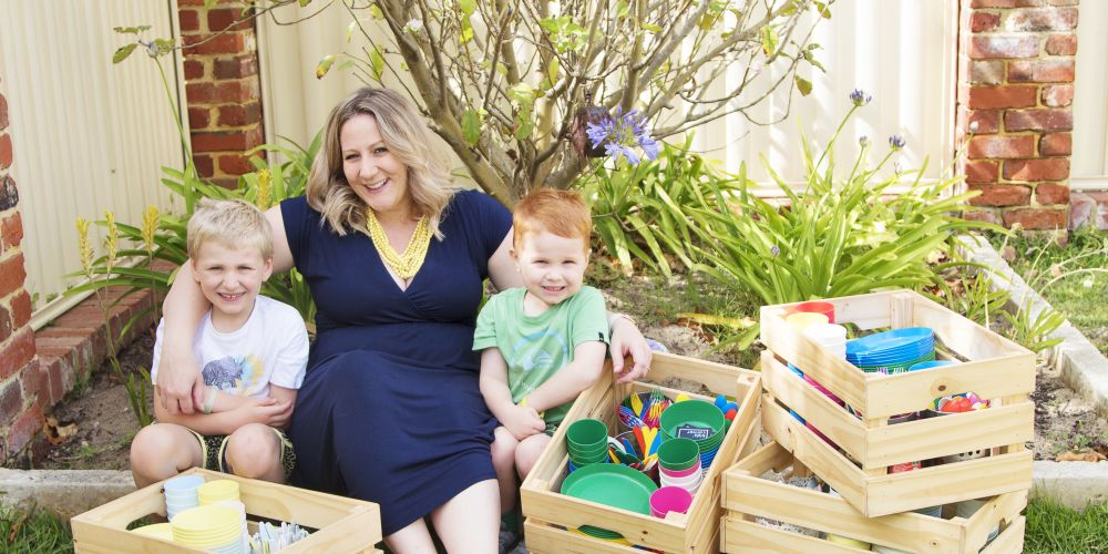 Suzie O'Bree with her sons Byron (6) and Zac (4) and the 'plate crates' she hires out for parties. Picture: Chelsea Woodbridge Photography