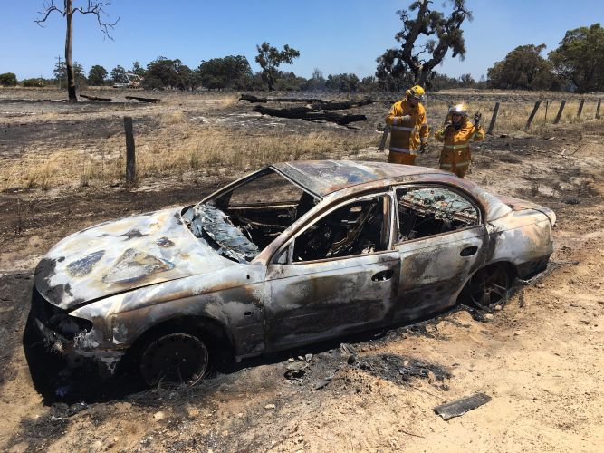 Firefighters inspect the car that is believed to have sparked an emergency warning in Nambeelup. Picture: Ray Raab/7NEWS
