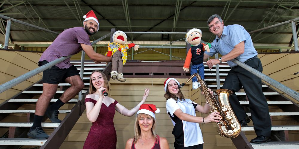 L-R: Rod Manton (Sports Chaplain) with Charlie (Puppet), Emily Schinkel (Singer), Karen van Namen (Sports Chaplain), Sophie Giraudo (On Saxaphone from the Combined Districts Concert Band) and Pastor Ian Kirk (Organiser) with Dil (Puppet). Picture: Dabid Baylis.    www.communitypix.com.au    d496917