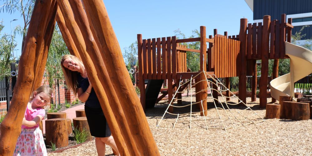 MercyCare Banksia Grove Early Learning Centre manager Kelley Meyn with Payton (5) enjoying the new nature play playground. Picture supplied