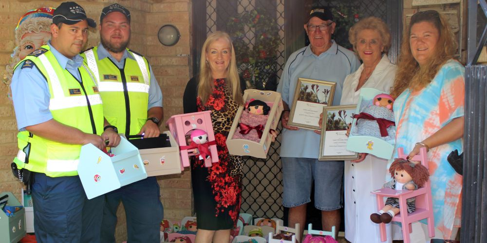 Wanneroo rangers Graham and Andrew, Mayor Tracey Roberts and councillor Natalie Sangalli collect toys from Selwyn and Sue Anderson, which will be distributed as part of the Mayor's Christmas Appeal. Picture: City of Wanneroo