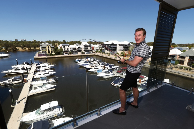 Mr Blackburne says it is possible to throw a line over some of the balconies at Marina East and fish from the river.