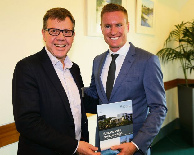 Michael Carter from the Chamber of Commerce and Industry of WA and Joondalup Mayor Albert Jacob with a copy of the Economic Profile and Opportunities Publication.