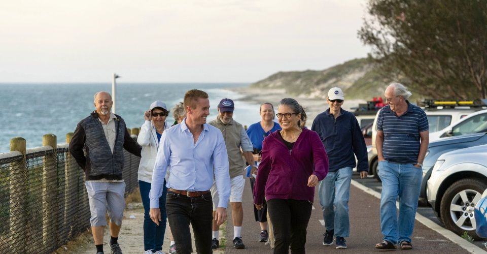 Joondalup Mayor Albert Jacob and Lee Graf take a stroll with members of the Befriend Burns Beach Walkers.