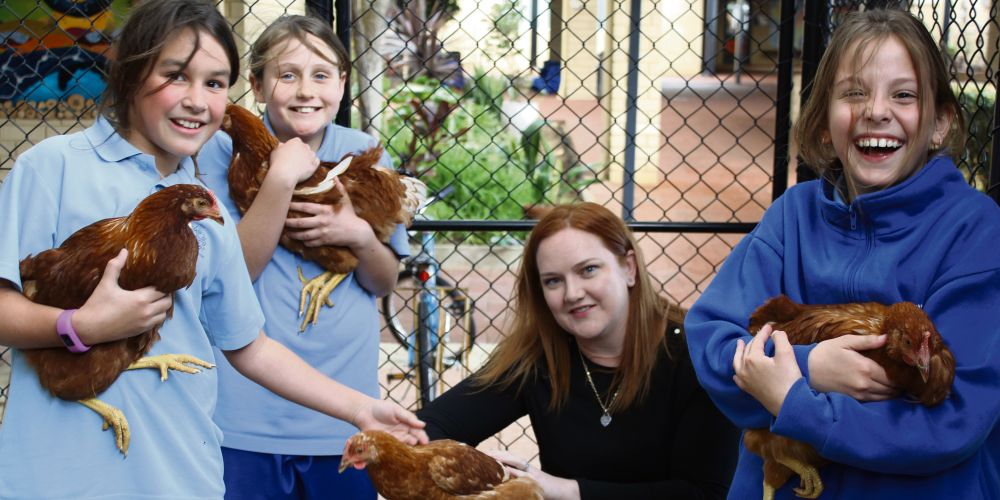 Kingsley MLA Jessica Stojkovski with St Luke's Catholic Primary School students who are ready for their Closing the Recycling Loop with Chickens project.