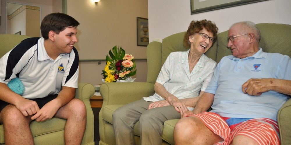 Workplace student Tim Armstrong with Mercy Place Edgewater residents Mary Smith and Kenneth Thorpe.