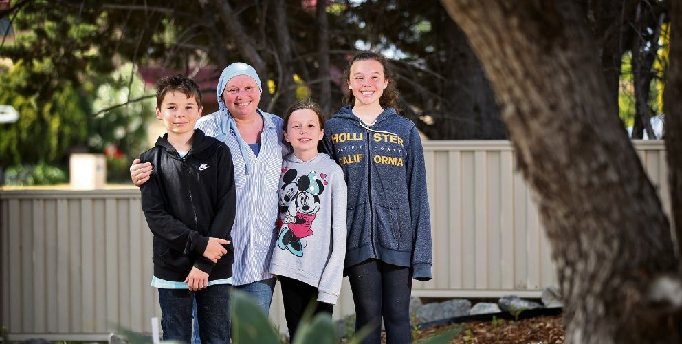 Sara Williams, of Ocean Reef, with her children Callum (12), Amber (10) and Jasmine (12) in their newly renovated garden. Picture: David Baylis d497011