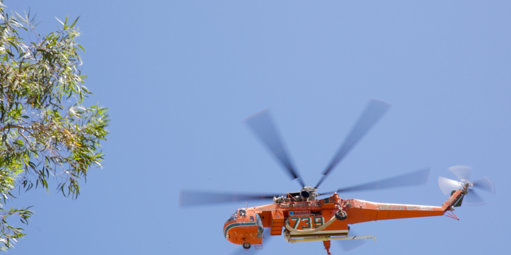 'Georgia Peach', an Erickson Air Crane fire bombing helicopter. Picture: AAP Image/Richard Wainwright