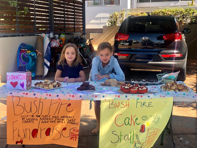 Trigg sisters Poet (5) and Allegra (9) Downie held a cake stall to raise money to support people affected by bushfires