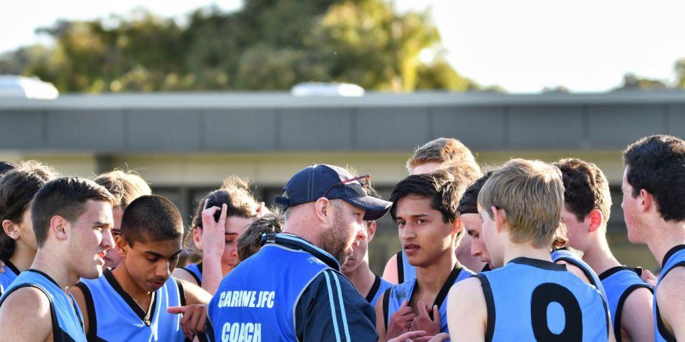 Carine Junior Football CLub head coach Michael Farmer with players