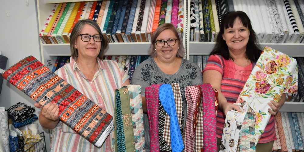 Volunteer sewist Sandra Bryans, My Fabricology owner Susan York and volunteer sewist Tracee Forster. Picture: Kristie Lim