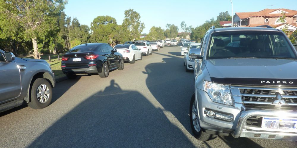 Cars parked on Spoonbill Road in Stirling in protest to a proposed childcare centre.
