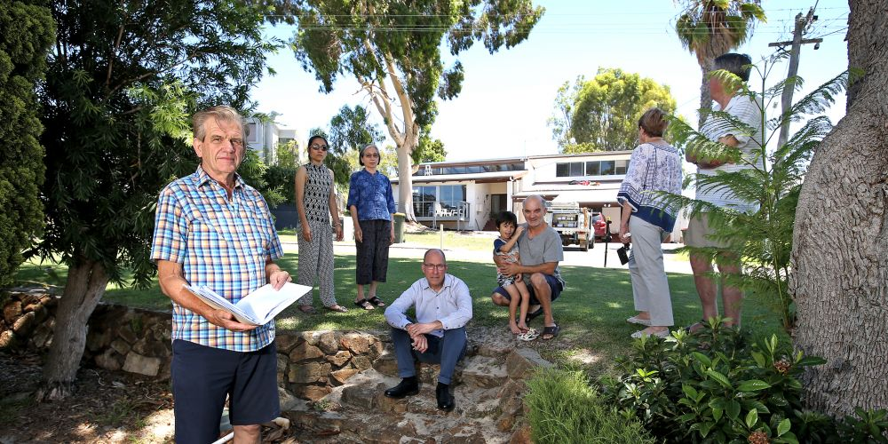 Dianella resident Graeme Lienert and neighbours are concerned about a home-based vet clinic proposed for the home pictured behind them. site in the background.  Photo: David Baylis d497518