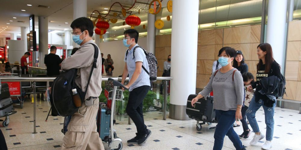 Passengers from Wuhan arrive in Sydney. Photo: Getty