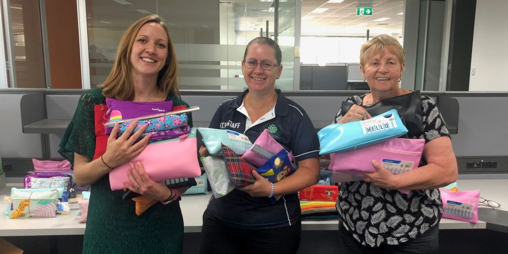 Clarkson Community High School teacher Louise Hall, Clare Stewart and Wendy Hillier collect stationery packs from Give Write. Picture supplied
