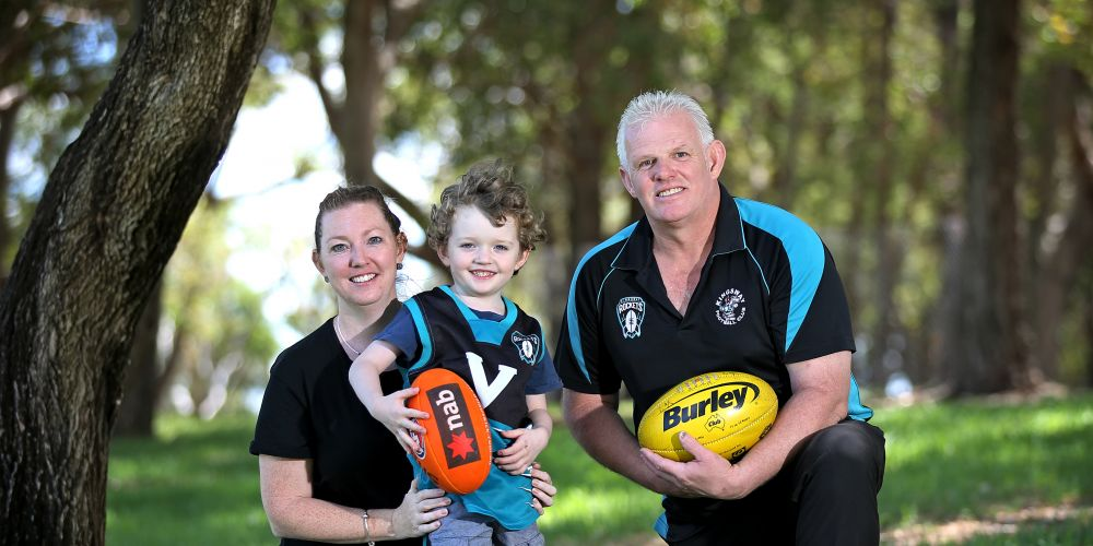 Madeley resident Lauren Bridges with her son Lachlan Hyatt (4) and Kingsway Junior Football Club president Clint Miller. Picture: David Baylis www.communitypix.com.au d497826