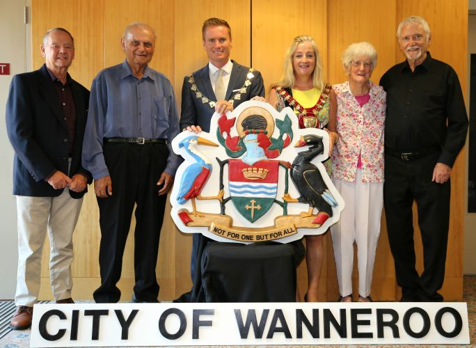 Joondalup honorary Freemen Brian Cooper, Nick Trandos, Margaret Cockman and Bill Marwick with Joondalup Mayor Albert Jacob and Wanneroo Mayor Tracey Roberts holding the crest. Picture supplied