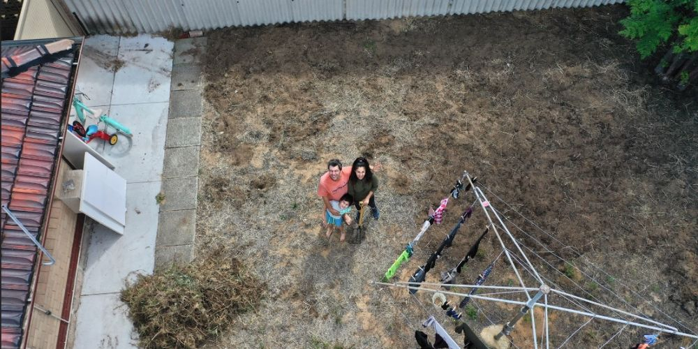 Chris Ferreira with his ex-wife and son in her backyard during their COVID-19 isolation. Photo: Chris Ferreira.