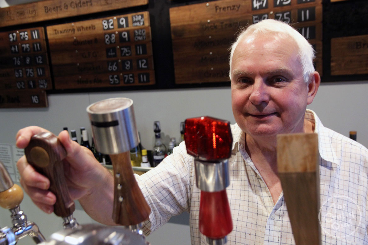 Peter Rogers with his tap handles at Bentspoke brewpub