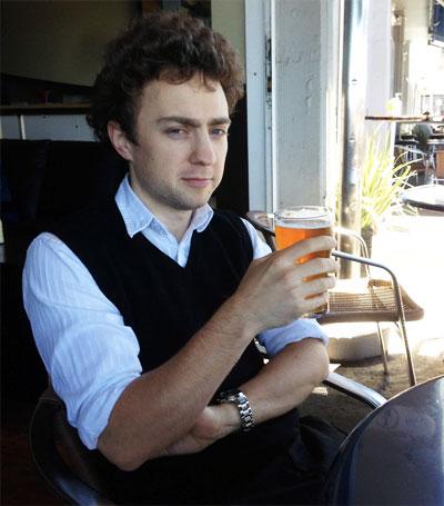 Sam Fletcher enjoys a beer in Tassie