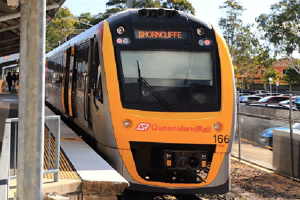 Queensland Trail train stopped at a station showing Shorncliffe as the destination
