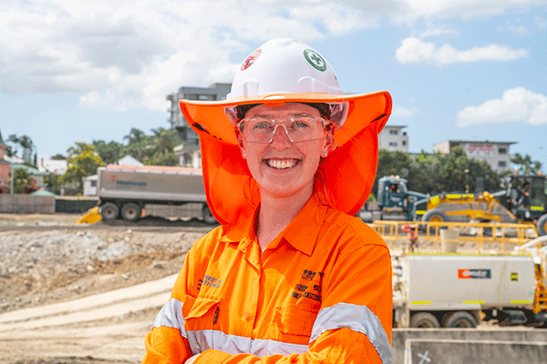 Young woman wearing high visibility safeyt gear on a construction site.