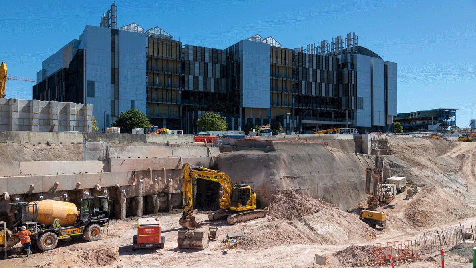 construction workers at the Boggo Road site with the Ecosciences building in the background.