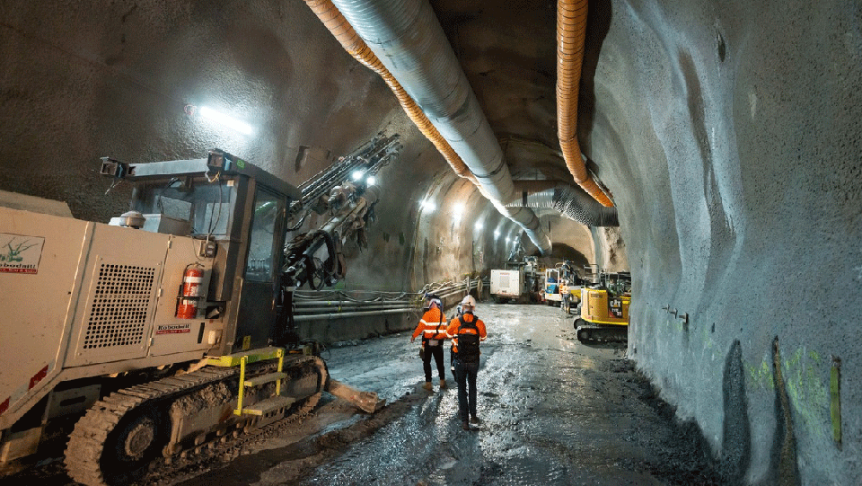 underground construction works with machinery and workers.