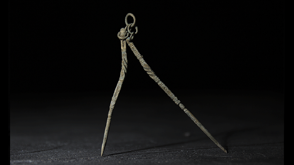 metal chatelaine with two picks joined by a small metal chain
