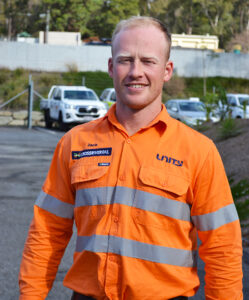 Smiling person in high vis uniform